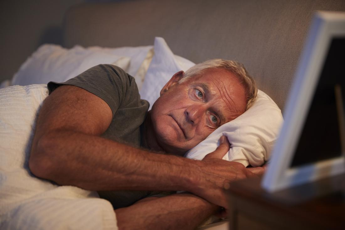 man dealing with insomnia