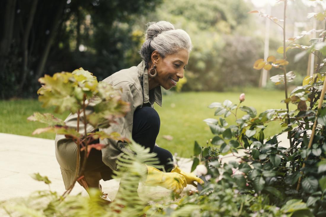 Senior woman outside gardening.