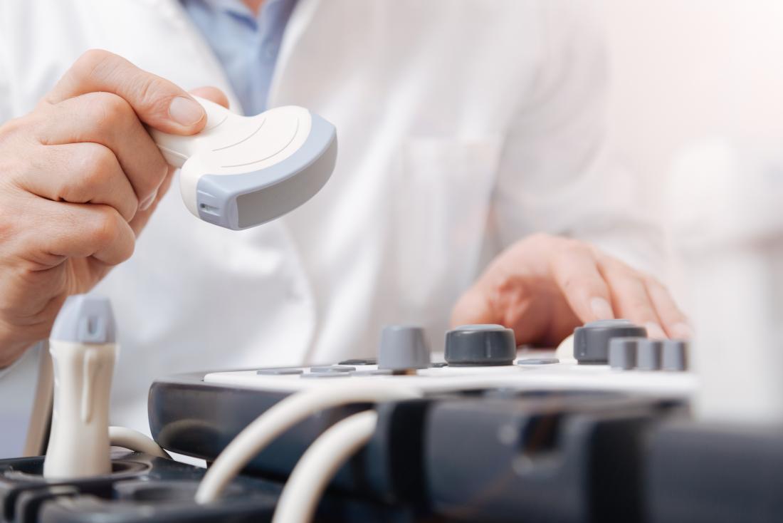 Ultrasound technician with equipment.