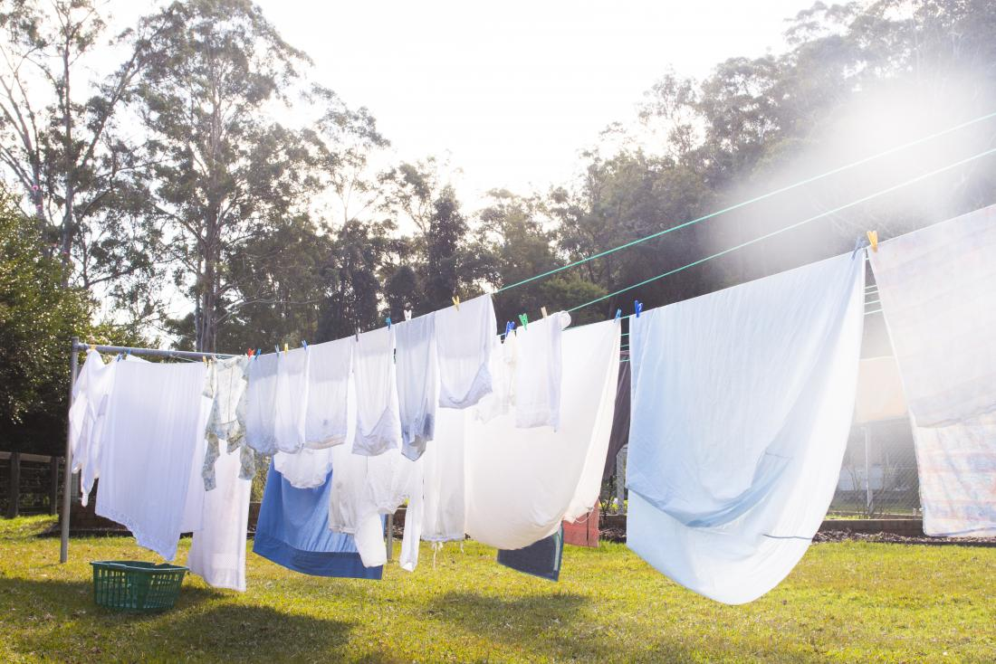 Clothes drying on washing line outdoors in garden.