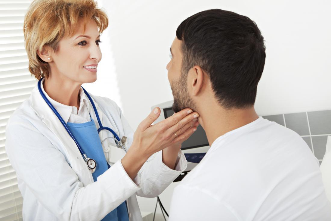 Dermatologist inspecting patients face.
