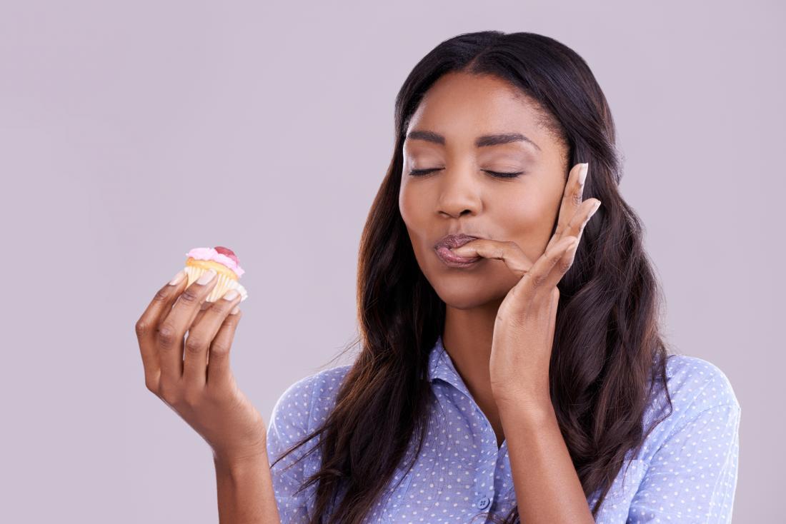 woman enjoying cupcake