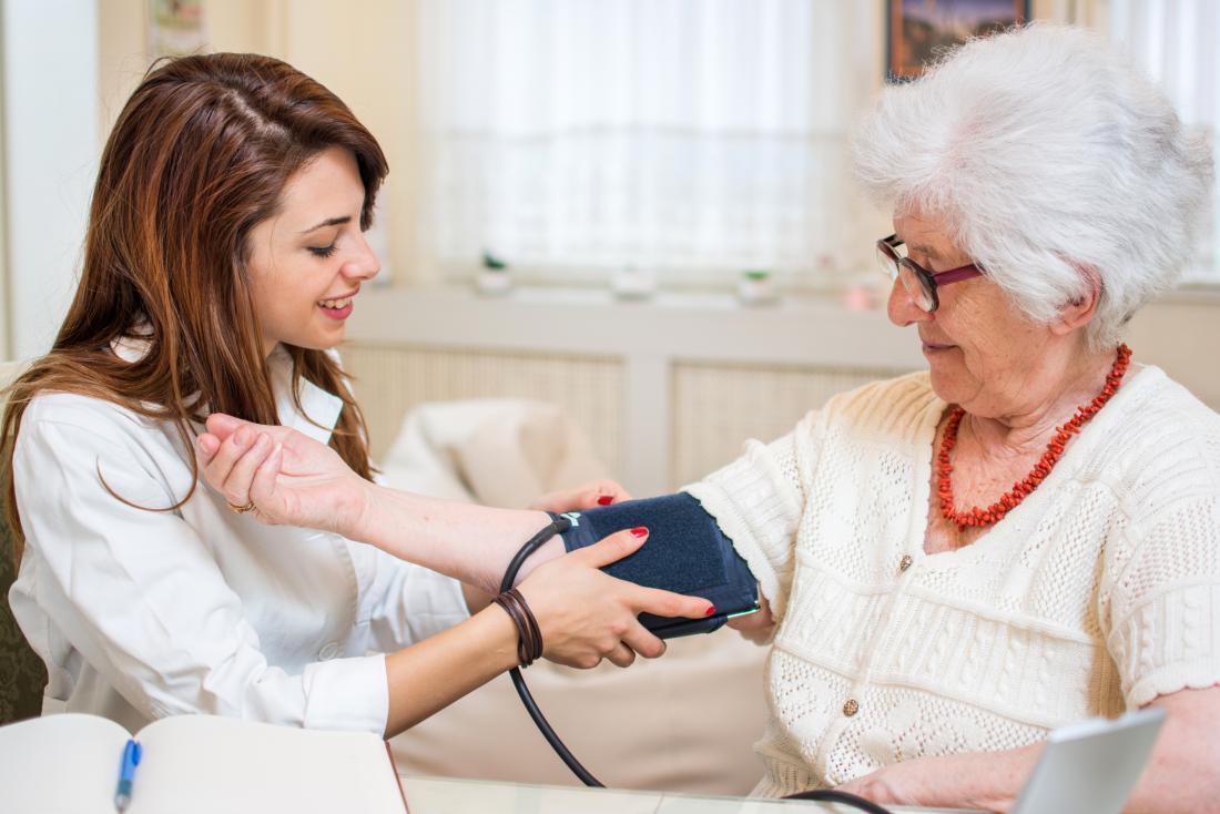 Senior woman having her blood pressure taken