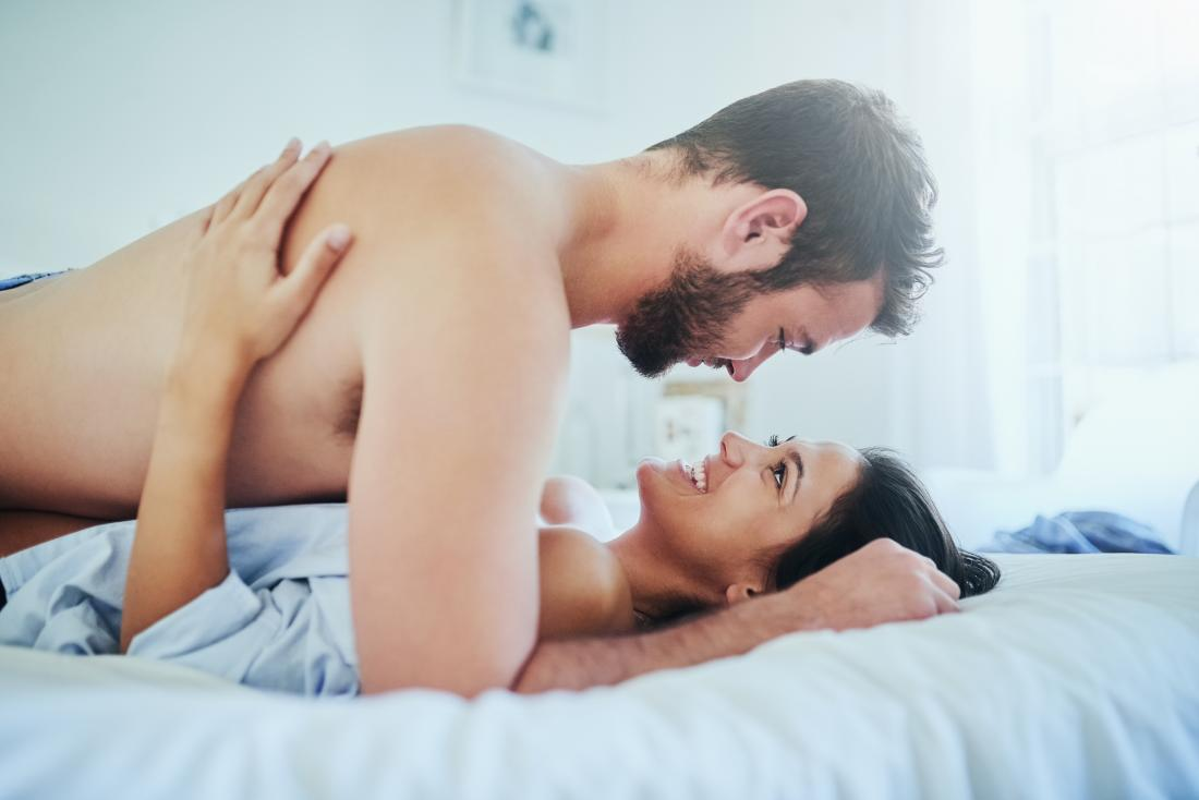 Couple communicating in bed about cervix penetration