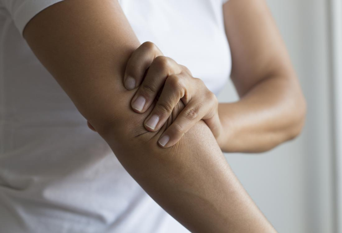 Stiff joints in elbow held by woman.