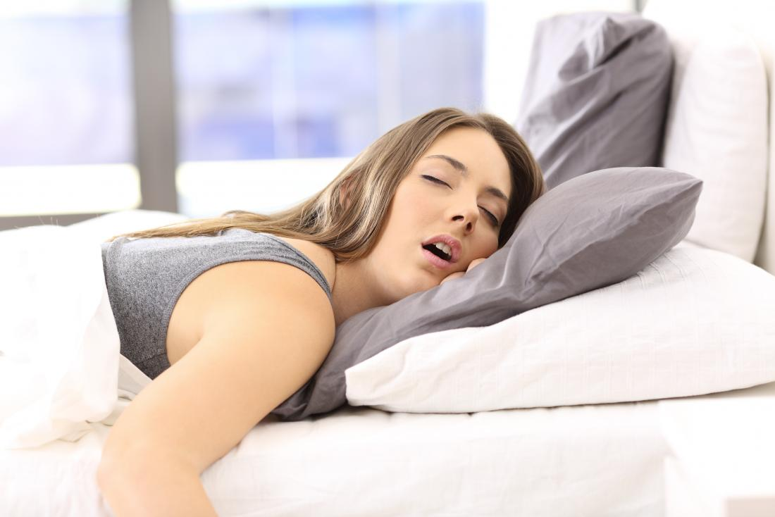 Woman sleeping in bed drooling
