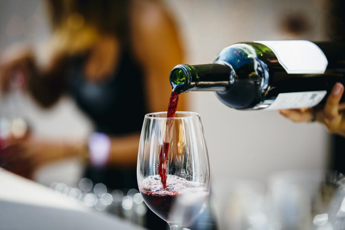 Red wine may be a cause of brown spots on teeth