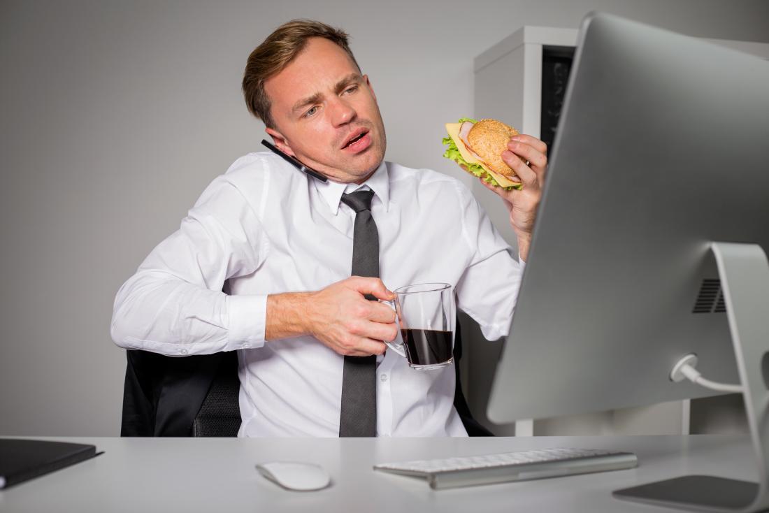 stressed man eating