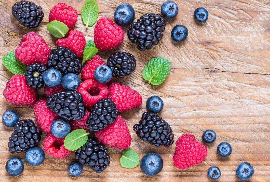 A variety of berries on a board