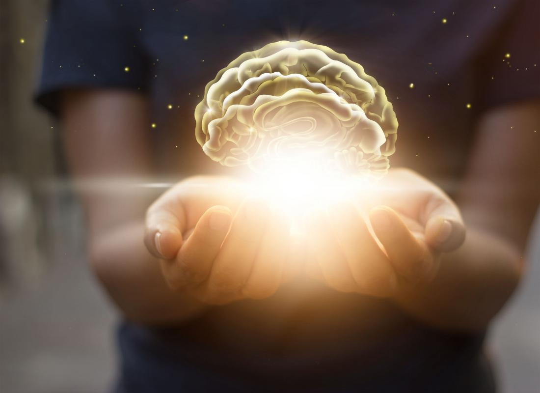 Brain boosted in hands and glowing