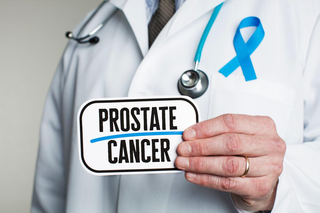 doctor holding prostate cancer sign