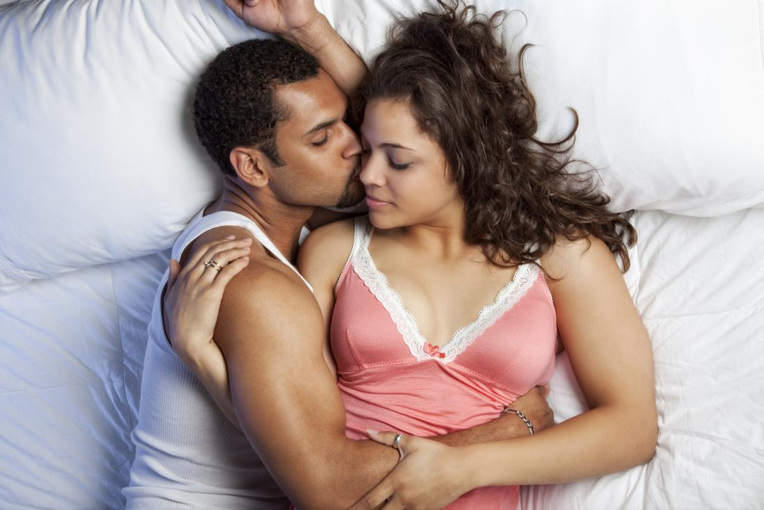 couple sharing an intimate moment in bed