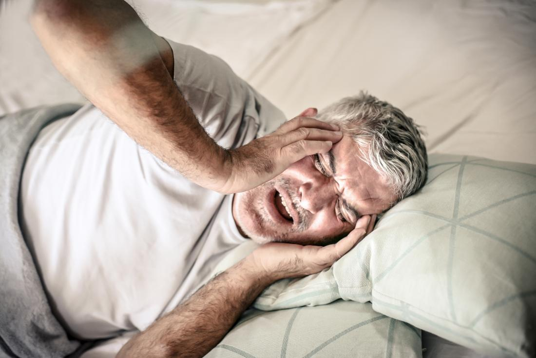 agitated man in bed