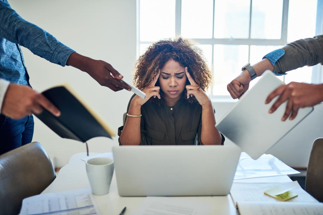 woman looking stressed at work