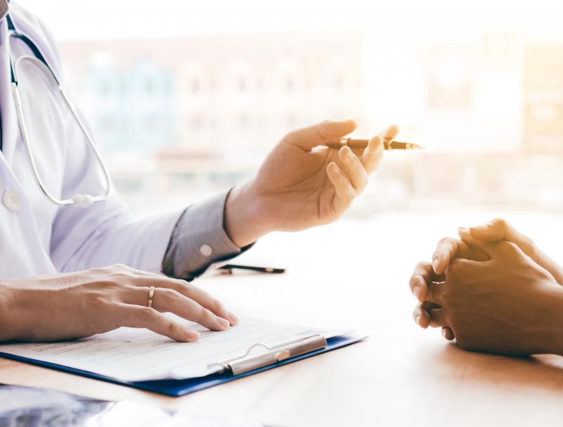 doctor speaking with patient about anal skin tags