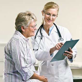 A woman consults with her doctor.
