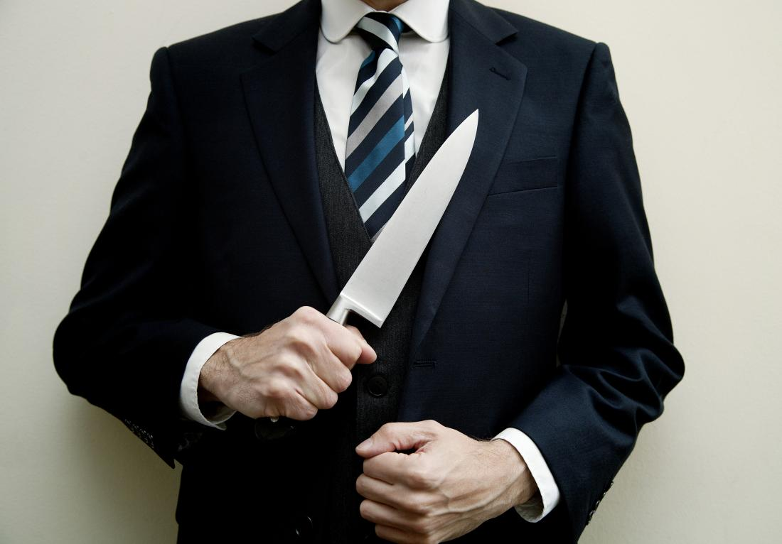 man in suit with knife