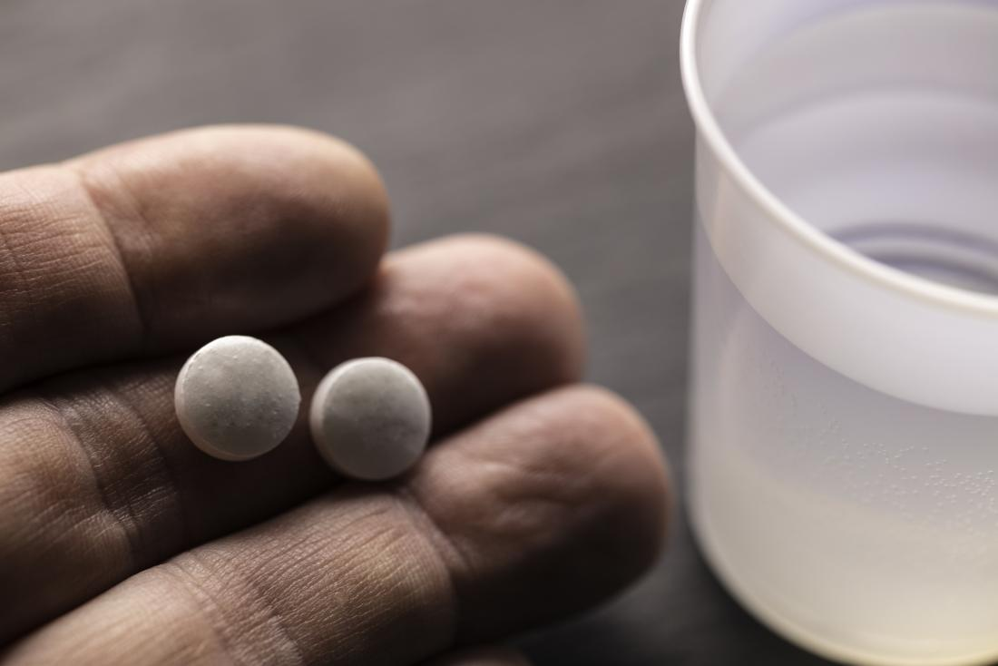 person holding two tablets