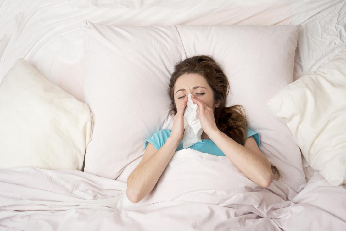 Woman in bed with a cold