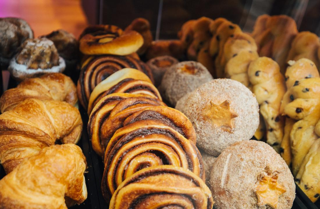 Baked good such as buns, cookies, and croissants that contain monoglycerides.