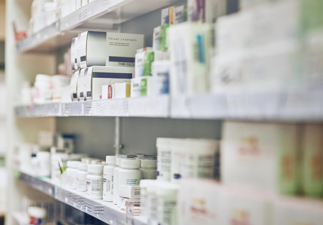 Pharmacy shelf with various medications.