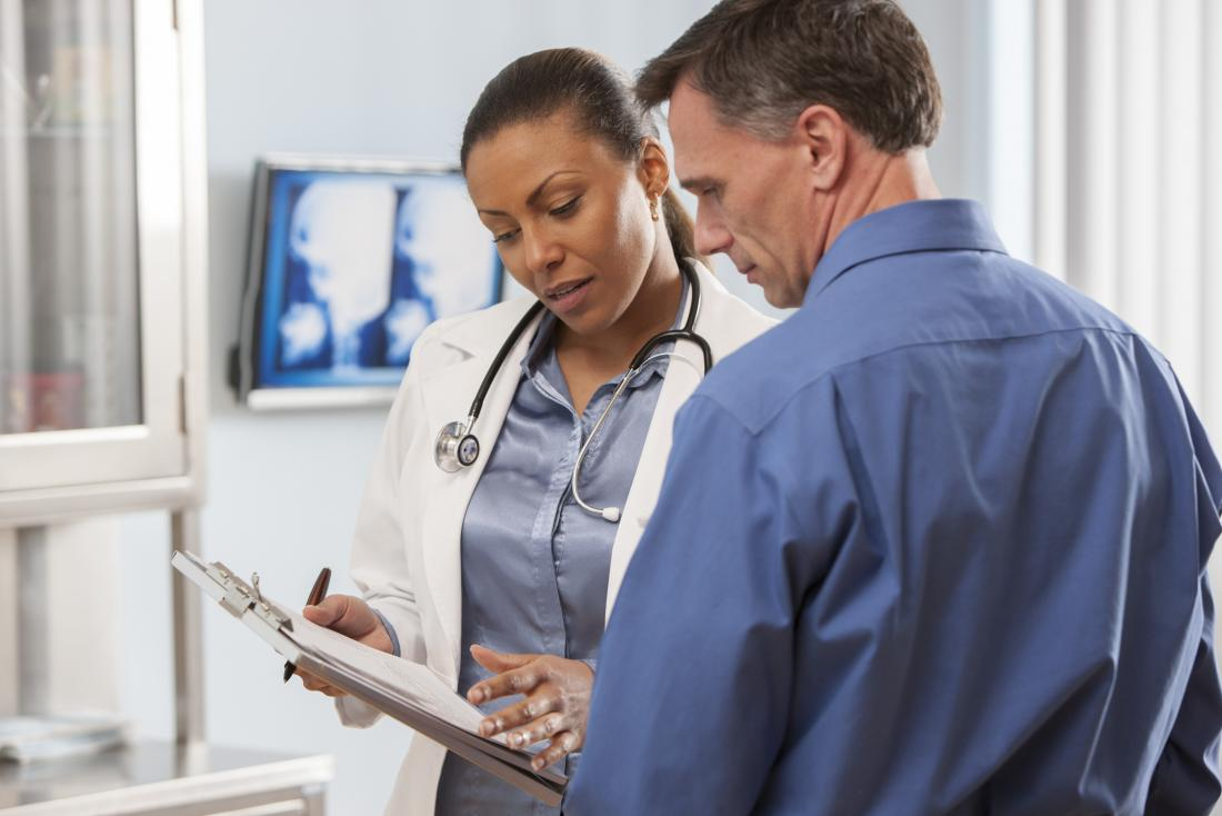 Doctor and patient with clipboard