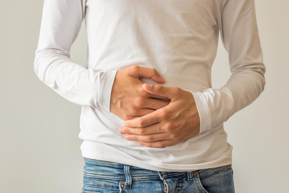 man holding stomach in pain.