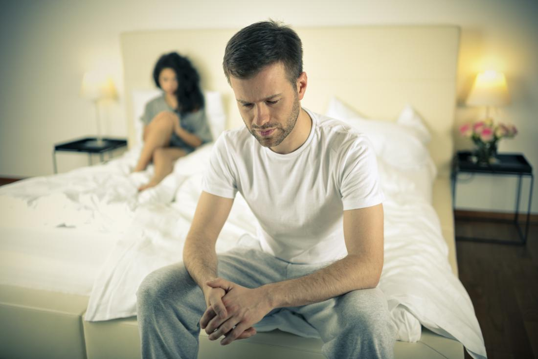 Anxious man sat on the end of his bed wondering if erectile dysfunction can be reversed