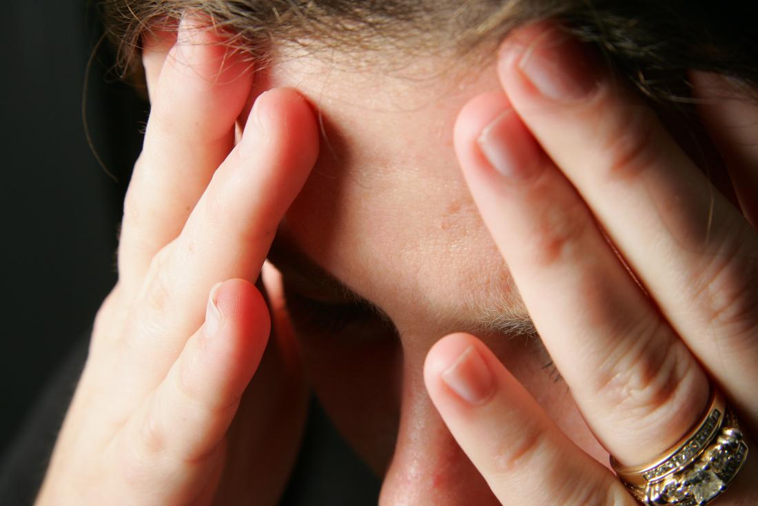 Man holding head due to head injury