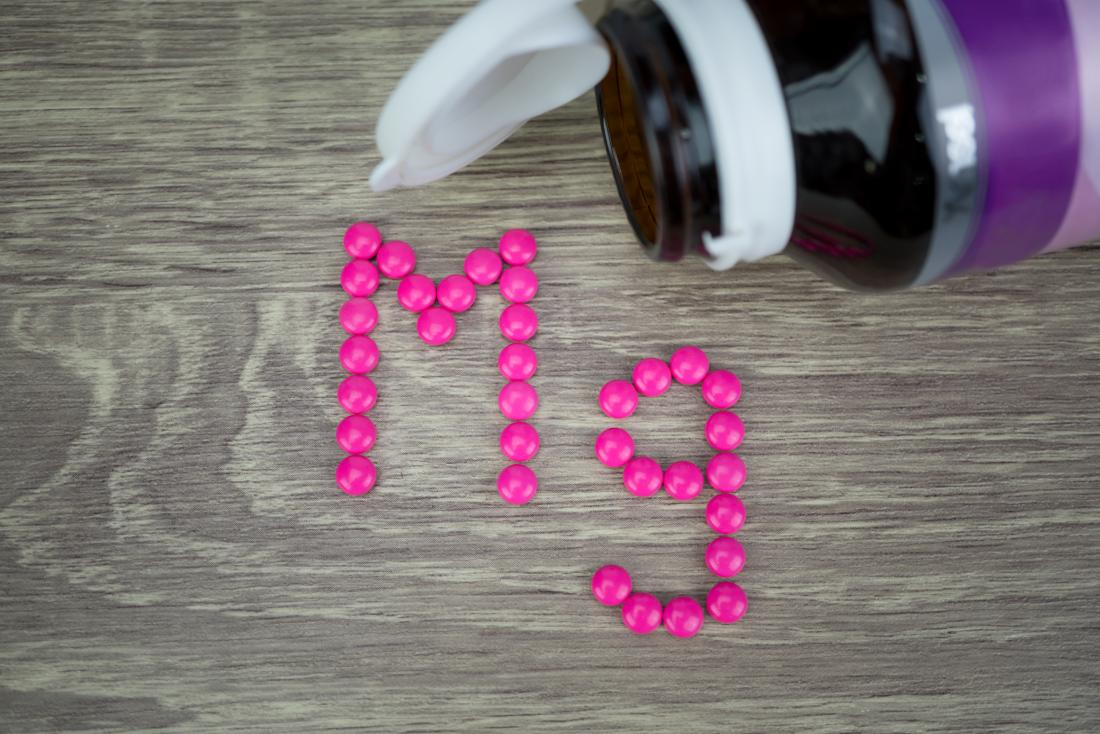 Magnesium pills spelling out mg