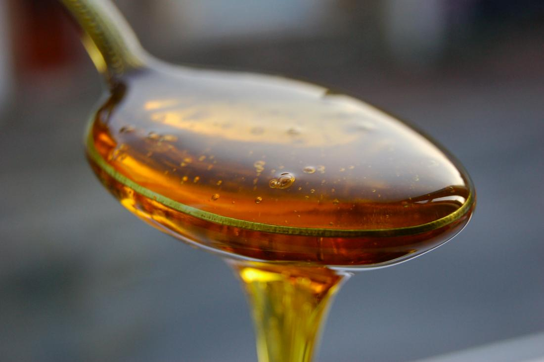 Spoonful of honey as natural remedy for burn on roof of mouth.
