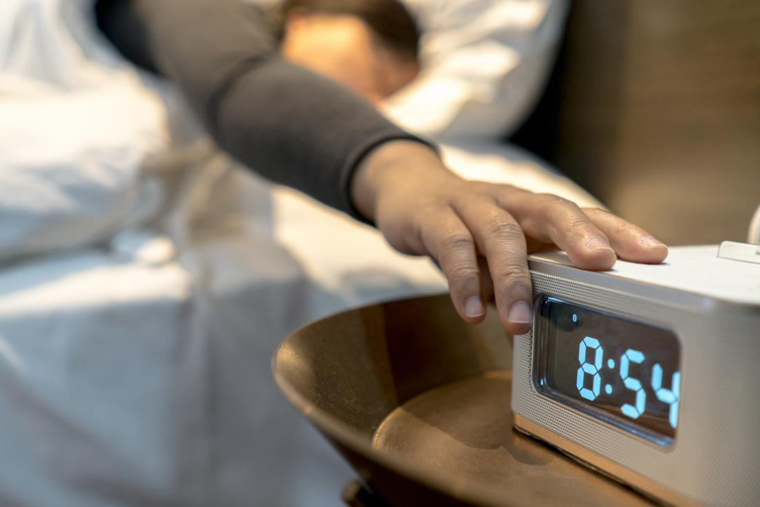 person snoozing alarm