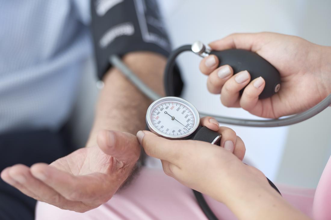 Nurse measuring patients blood pressure.