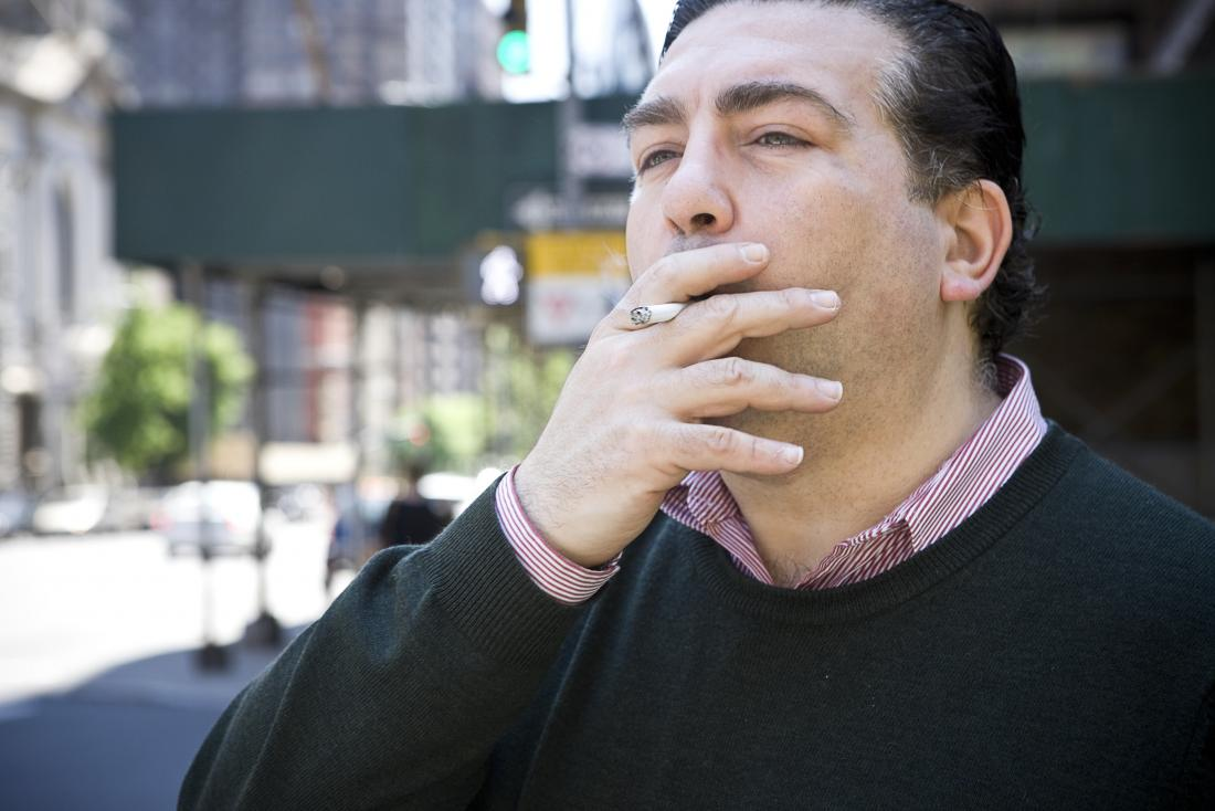 Middle aged man smoking cigarette