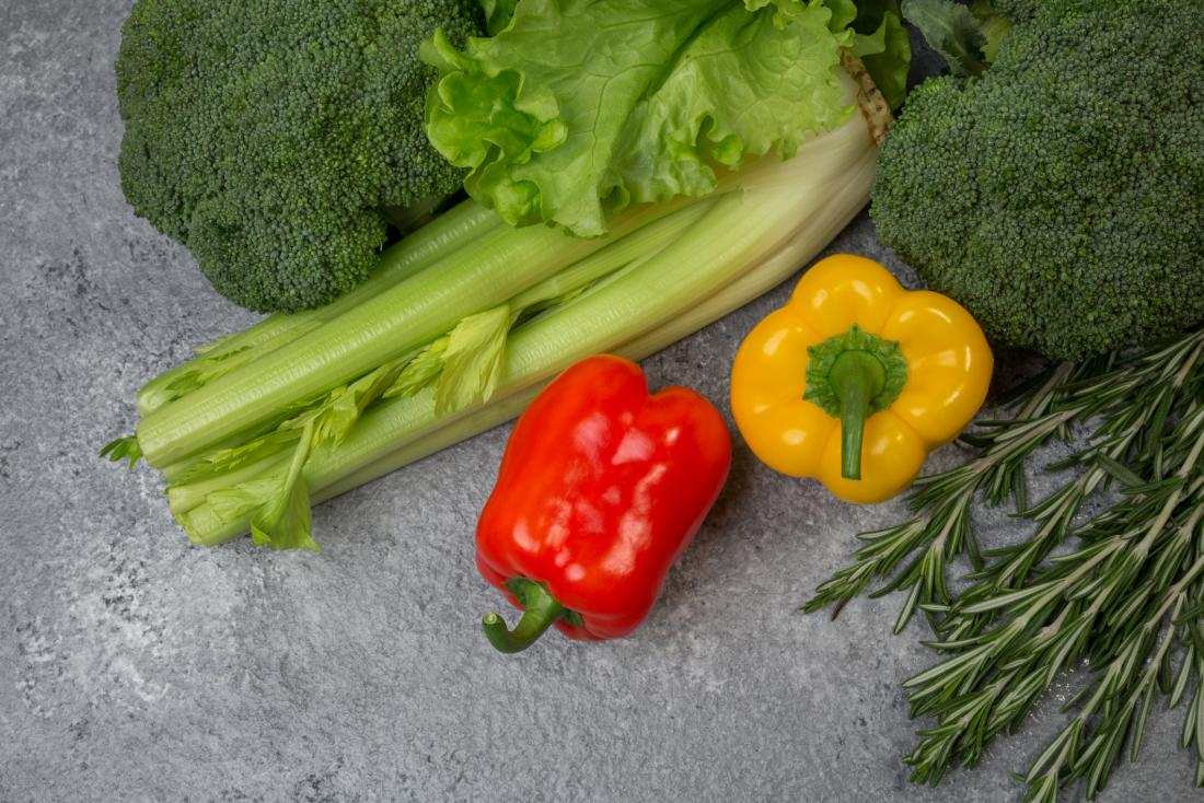 red and yellow peppers, leafy greens