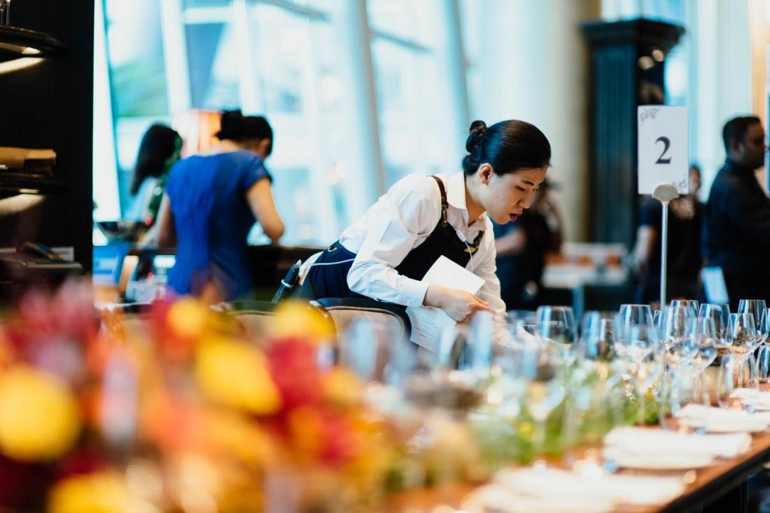 woman setting the table in a catering job