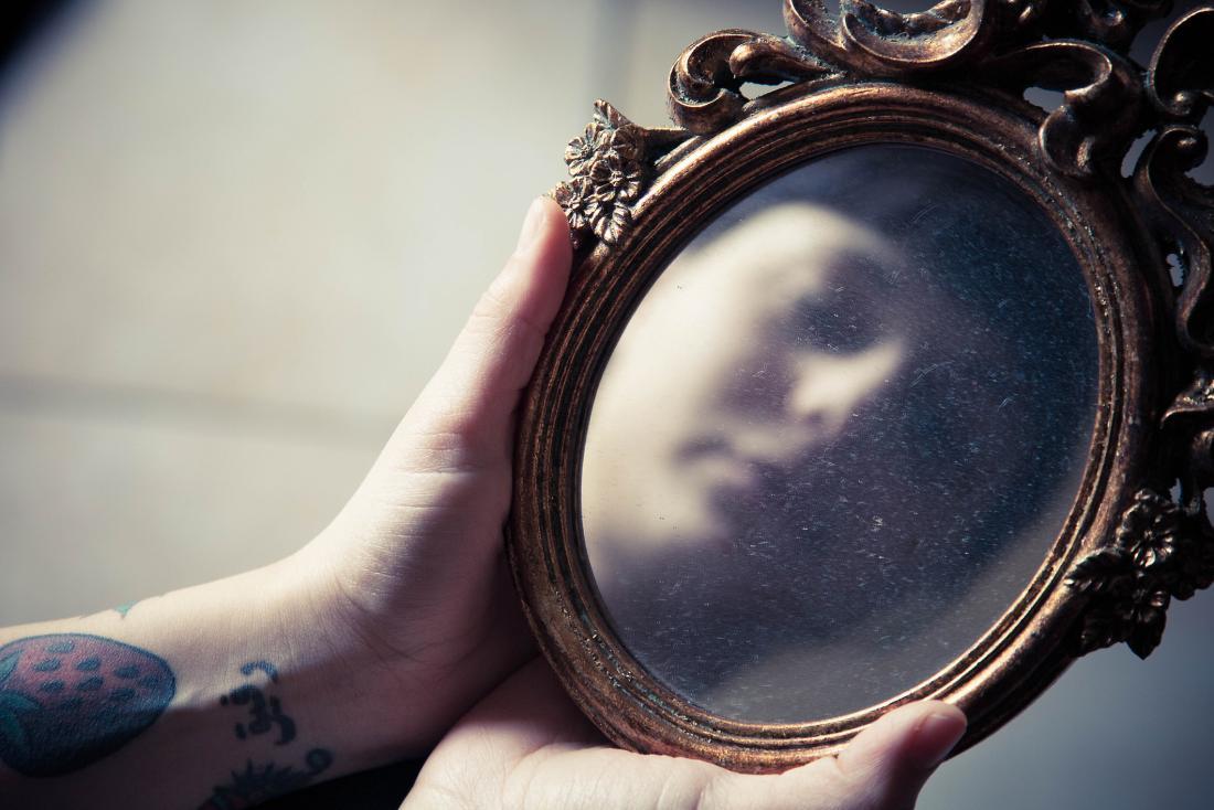 reflection in a dusty mirror