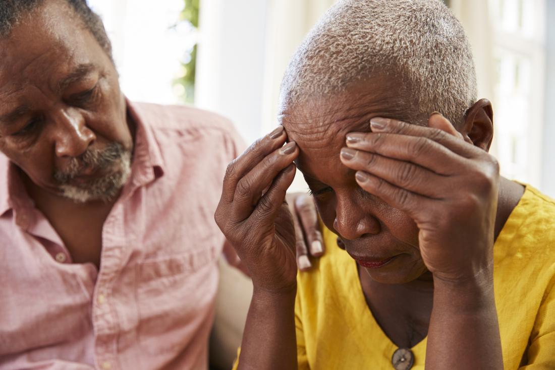senior man consoling senior woman<!--mce:protected %0A-->