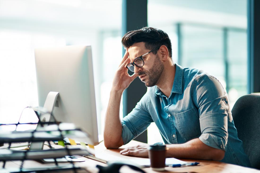 Man looking anxious at work