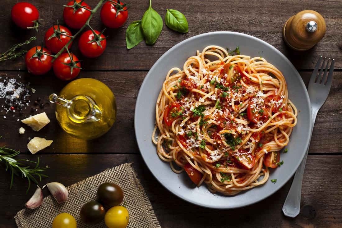 Tomato spaghetti pasta dish with olive oil, tomato, garlic, and cheese