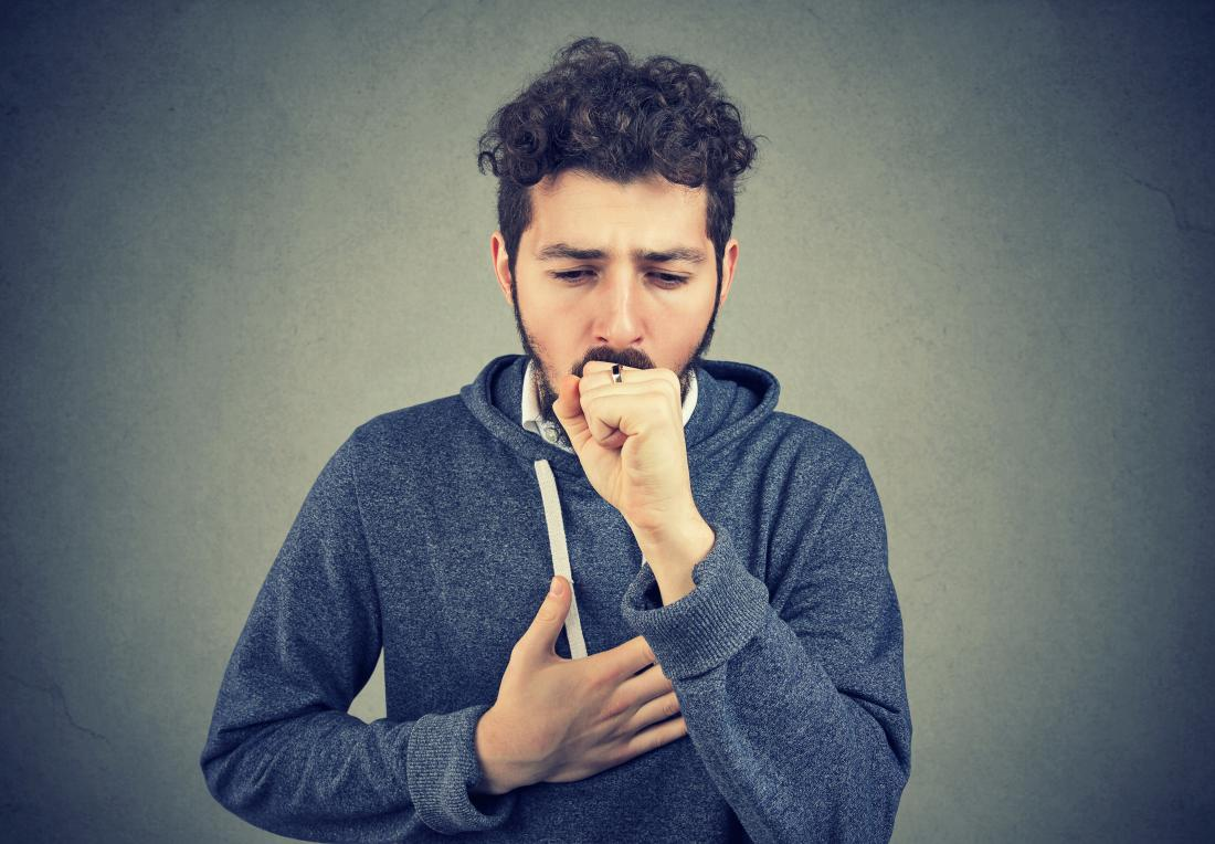 man coughing and having difficulties breathing which could be caused by bibasilar atelectasis