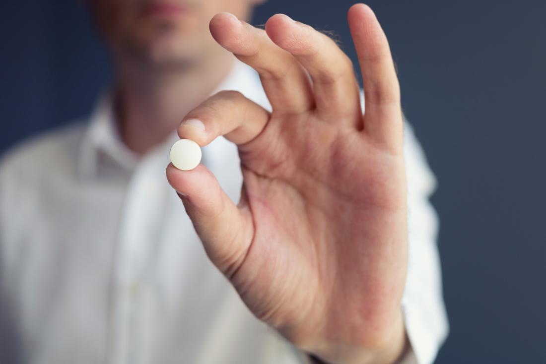 man showing a pill