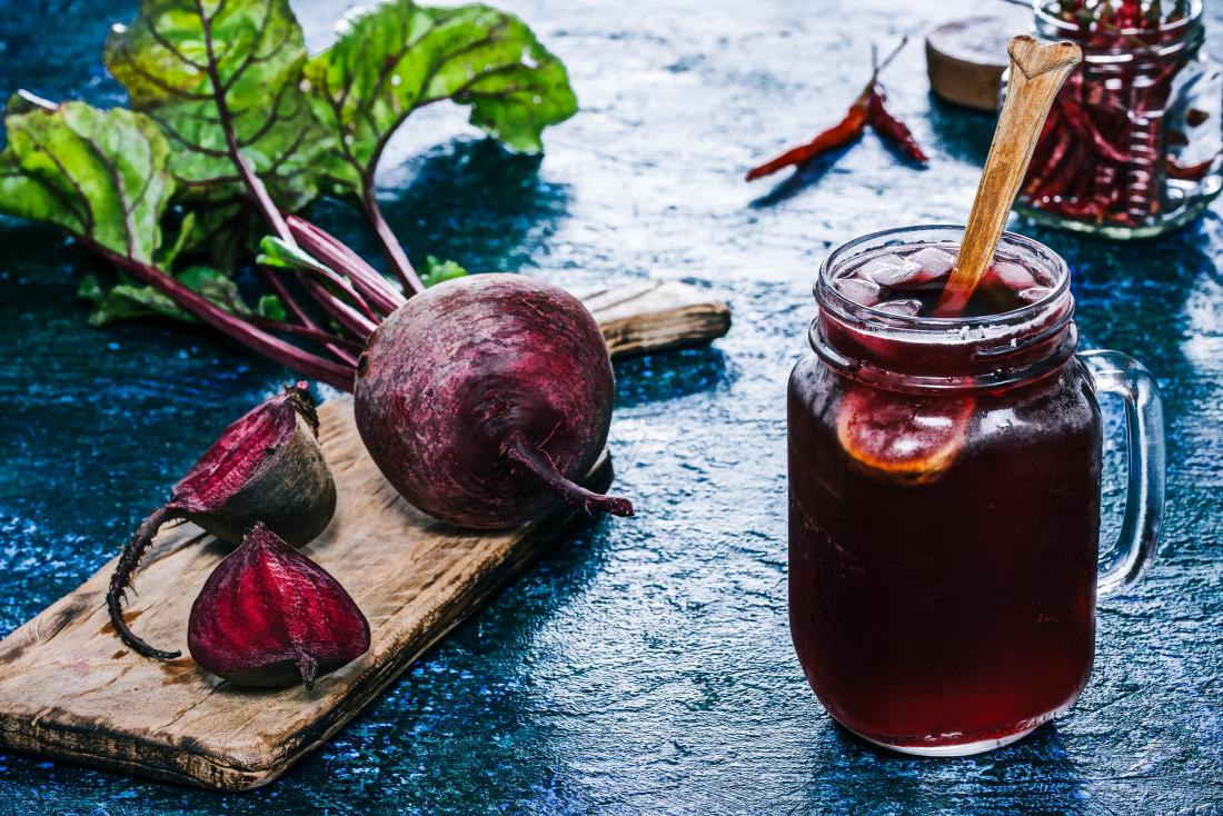 Beetroot on a board and beet juice may help with ED
