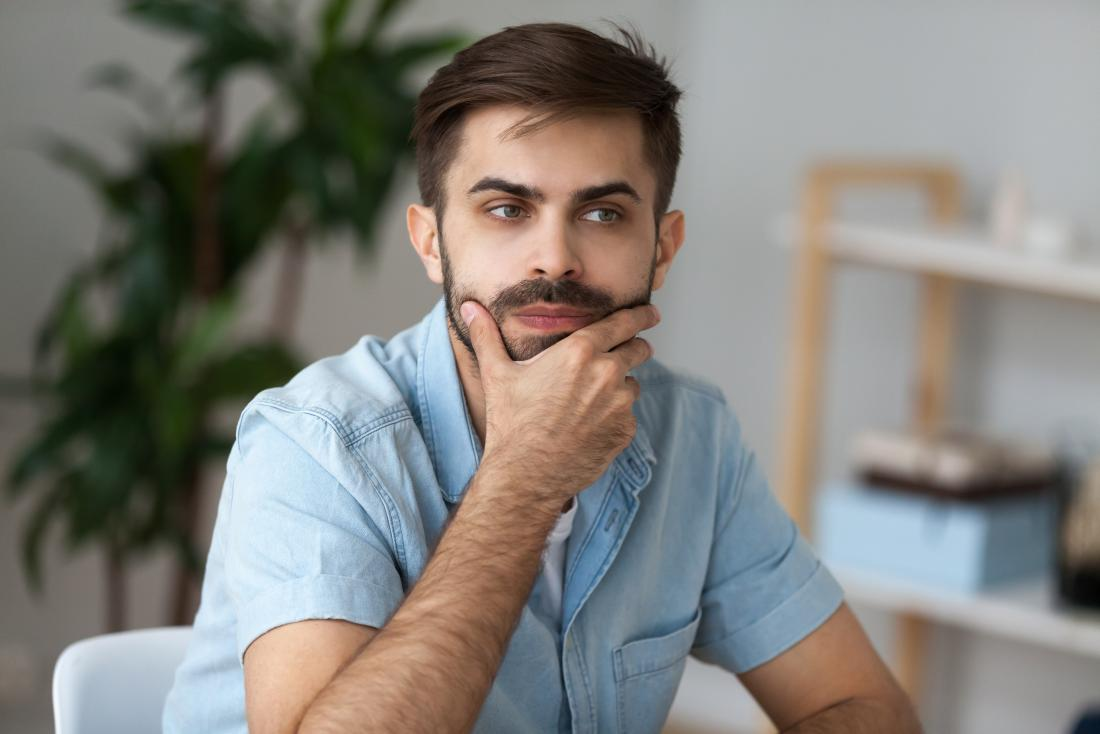 young man looking pensive