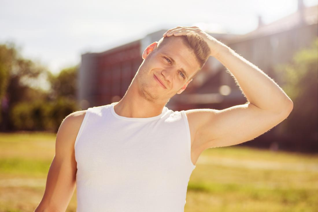 Man stretching his neck outdoors before sports
