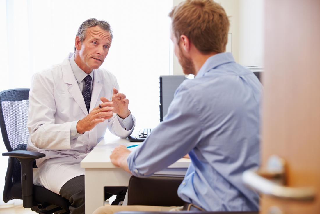 Doctor speaking in office to male patient
