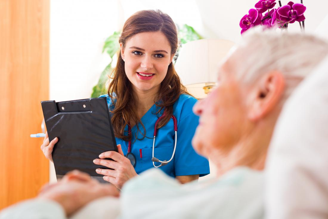 Doctor visiting with senior patient