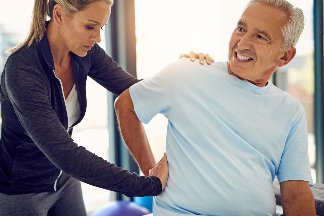 Man with lower back spasm receiving physical therapy