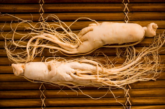 [ginseng root on a bamboo mat]