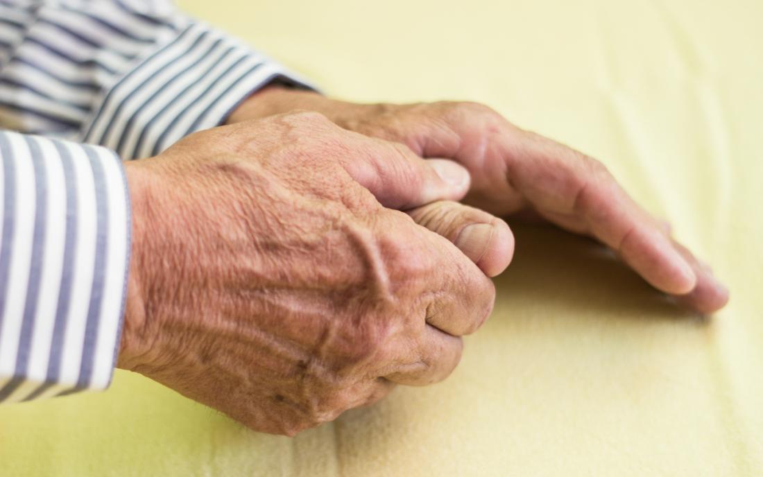 close up of senior mans hands